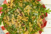 pic of italian parsley  - Italian pasta fusilli with fresh garlic and rocket leaves spanish chorizo parsley parmesan cheese on gingham plate white wood background - JPG