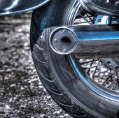 stock photo of crotch-rocket  - close up of a classic motorcycle rear wheel in hdr tone mapping effect - JPG