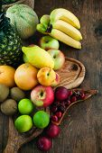 stock photo of exotic_food  - Fruit variety on wood - JPG