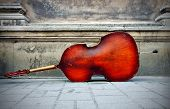 stock photo of double-bass  - Double bass on the background of the old wall - JPG