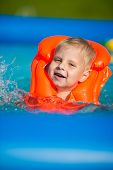 pic of pretty-boy  - Pretty little boy in swimming pool - JPG