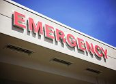 stock photo of emergency treatment  - the front entrance sign to an emergency room department in a city hospital - JPG