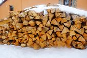picture of firewood  - Firewood in snow outdoors - JPG