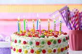 picture of striping  - Birthday cake with candle on colorful striped background - JPG
