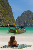 picture of phi phi  - Traditional longtail boats in the famous Maya bay of Phi - JPG