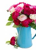 picture of blue rose  - bunch of pink  ranunculus and rose flowers in blue pot isolated on white background - JPG