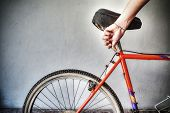 image of dirt-bike  - man repairing a mountain bike in a workshop - JPG