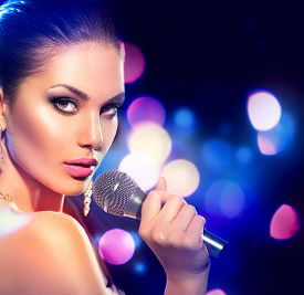 stock photo of karaoke  - Beautiful Singing Girl - JPG