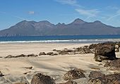 image of eigg  - view of mountians on rum seen across laig bay on ilse of eigg small isles of scotland - JPG