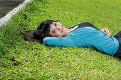 sweet young woman lying down
