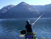 image of trout fishing  - fishing on the como lake shore and mountains - JPG