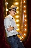 picture of peddlers  - young man with glass of champagne near the mirror in cabaret - JPG