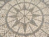 Mosaic In A Portuguese Sidewalk