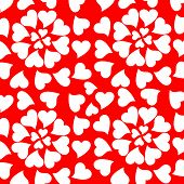 Seamless background randomly placed glowing valentine hearts