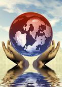 Pair Of Hands Holding The Earth