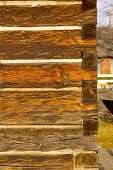 Portrait Photo Of Antique Square Log Construction