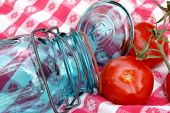 Grandma'S Vintage Canning Jar And Tomatoes On The Vine