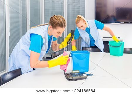 Commercial cleaning crew ladies working