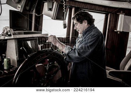 Ships captain at the wheel