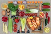 Health food to lose weight with fresh seafood, fruit, vegetables, dairy, nutritional supplement powd poster