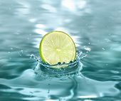 slice lime falling in a refreshing drink