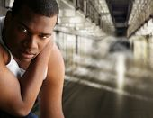 stock photo of lockups  - Portrait of a young man in jail - JPG