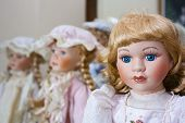 stock photo of edwardian  - Collection of vintage porcelain dolls in Victorian and Edwardian dress - JPG