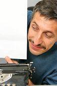 Man Looking To Blank White Sheet