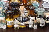 foto of belladonna  - Various pharmacy bottles of homeopathic medicine on dark background - JPG