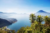 Beautiful lake Atitlan and volcanos in the highlands of Guatemala, Central America poster