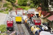 Set Of Red Electric Model Railway Locomotive And Layout With A Station And Whole Scene With Features poster