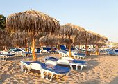 Beach With Umbrellas And Chairs