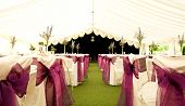stock photo of marquee  - Tables and chairs inside a wedding marquee - JPG