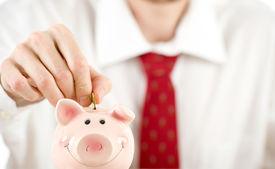 stock photo of save money  - businessman saving money - JPG
