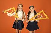 Education And School Concept. School Students Learning Geometry. Kids School Uniform On Orange Backg poster