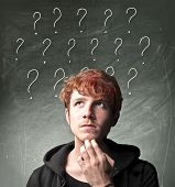 Young man with thoughtful expression and question marks over his head