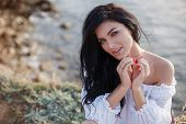Happy Woman On The Beach. Portrait Of A Beautiful Girl Close-up On Sea Background. Spring Portrait O poster