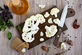 Cauliflower On A Cutting Board. A Beautiful Cut Of Cauliflower. Healthy Vegetable. The Top View poster