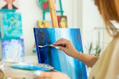 Art School, Creativity And Leisure Concept - Student Girl Or Young Woman Artist With Easel, Palette  poster