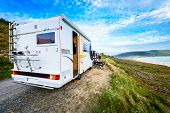 Motorhome Rv And Campervan Are Parked On A Beach. poster