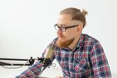 Radio Host Concept - Close-up Of Handsome Man Working As Radio Host At Radio Station poster