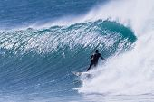 Surfer Surfing Rides Cold Wave poster