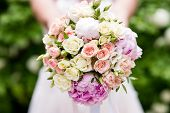 Bridal Bouquet. Wedding Bouquet In The Hands Of The Bride. Outdoor Shot In A Sunny Day With Green On poster