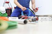 Electrician At Work With Nippers In Hand Cut The Electric Cable, Install Electric Circuits, Electric poster