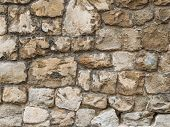 Stone Ancient Wall Paved With Cobble Stones, Closeup. Old Stone Wall. Stone Wall Background. Backgro poster