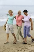 Women Walking Beach Together