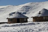 Lesotho African huts in snow