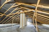 Attic Of A Building With Wooden Beams Of A Roof Structure. poster