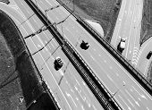 Aerial View Of Highway And Overpass In City. Aerial View Of Cars Crossing Interchange Overpass. High poster
