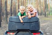 Cute Adorable Caucasian Blond Siblings Having Fun During Atv 4x4 Off-road Adventure Trip Amog Conife poster